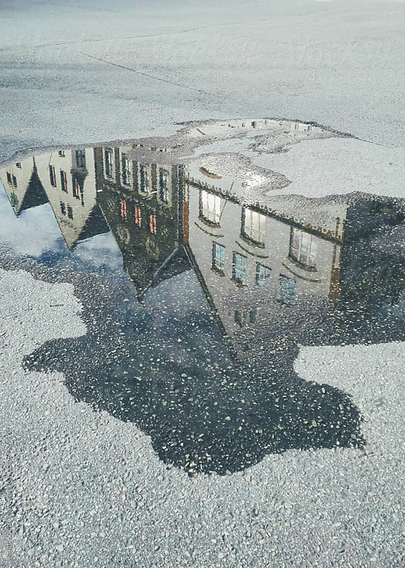 Bergen 1900's Houses reflected in a puddle  by Kaat Zoetekouw for Stocksy United