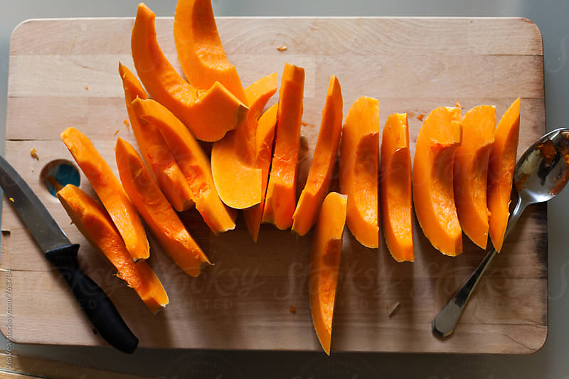 Slices of pumkin on a table from above  by Marija Mandic for Stocksy United