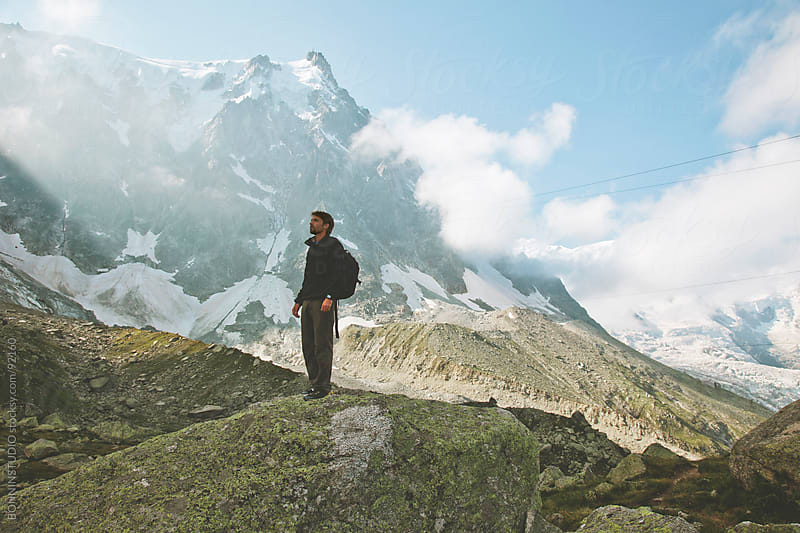 Man standing contempling mountain landscape. France. by BONNINSTUDIO for Stocksy United