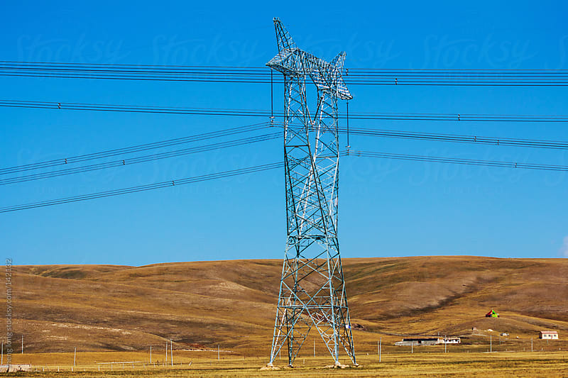 Electric tower in the grasslands by zheng long for Stocksy United