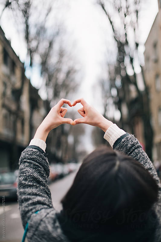Woman showing heart symbol with her hands by Marija Mandic for Stocksy United