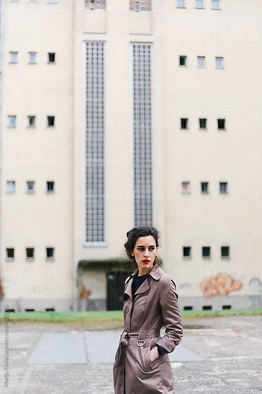 Stylish woman in front of a building by Marija Kovac for Stocksy United