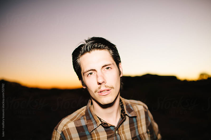 Young man at sundown by luke + mallory leasure for Stocksy United