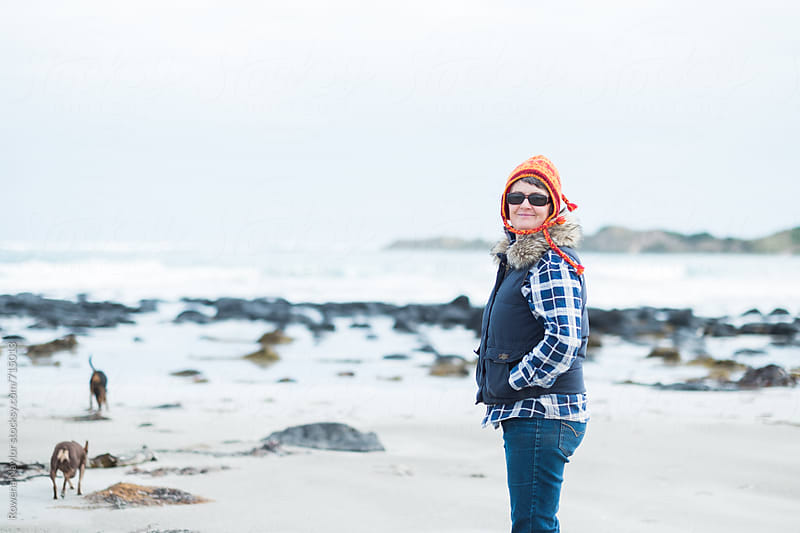 Wintery beach walk with dogs by Rowena Naylor for Stocksy United
