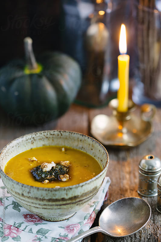 Pumpkin soup: Pumpkin soup with sage and walnut pesto. by Darren Muir for Stocksy United