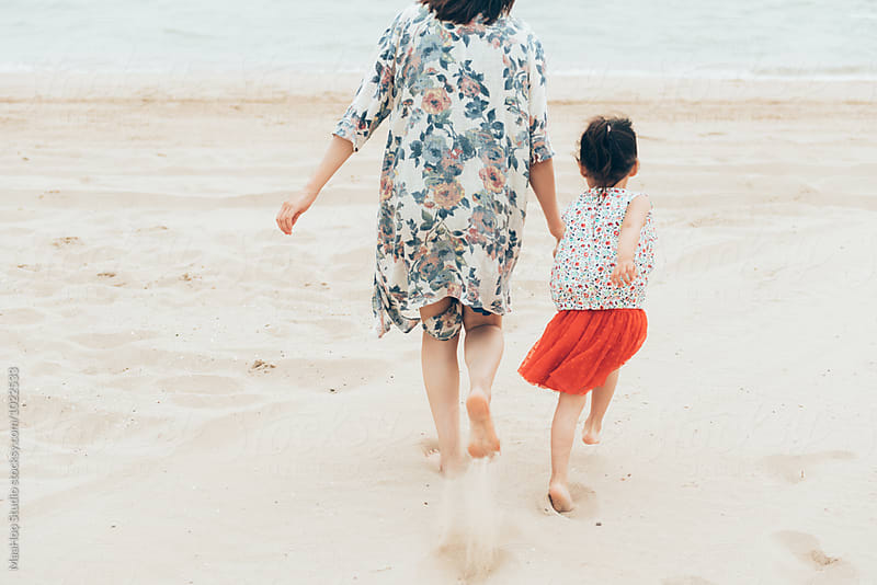 Cute toddler girl and her mother on the seaside by MaaHoo Studio for Stocksy United