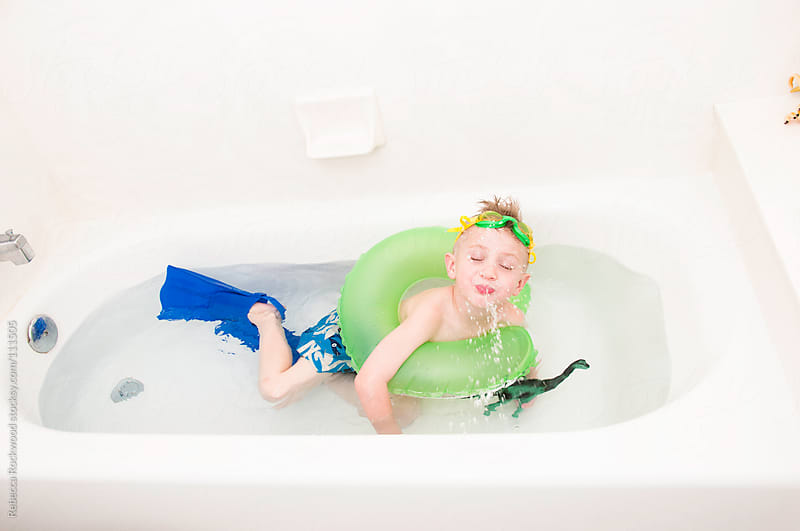 bath time fun by Rebecca Rockwood for Stocksy United