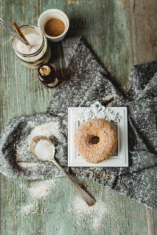 Donut with sugar and cinnamon by Tatjana Ristanic for Stocksy United