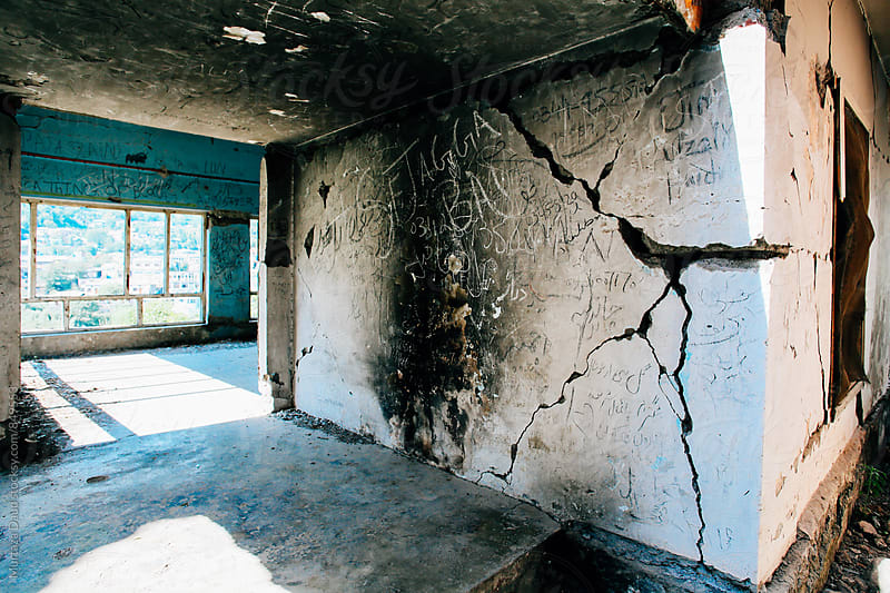 An old broken building with cracked walls by Murtaza Daud for Stocksy United