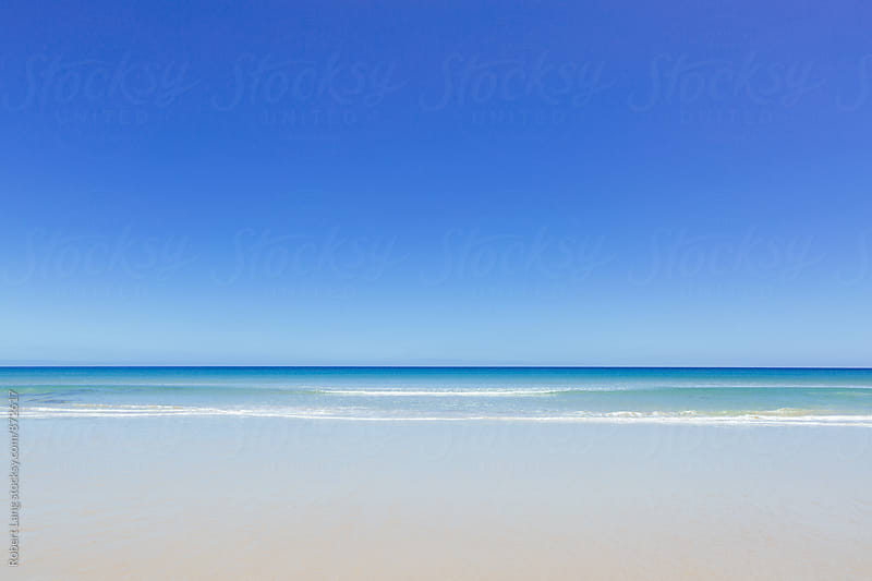 An empty beach during summer in Australia by Robert Lang for Stocksy United