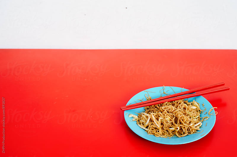 Street food - noodles by Artem Zhushman for Stocksy United