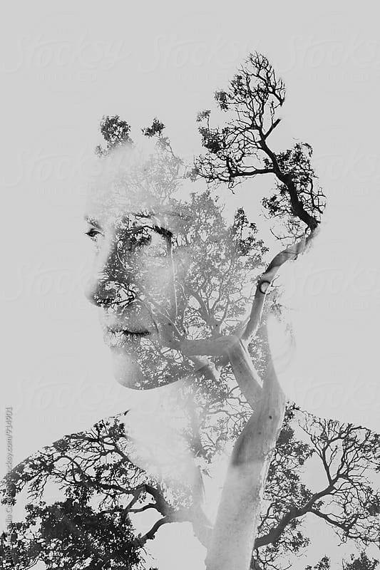 Double exposure of young woman with trees by Rob and Julia Campbell for Stocksy United