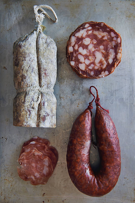 Assorted cured meats charcuterie by Jill Chen for Stocksy United