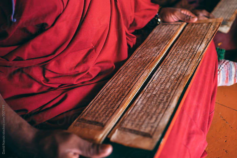Monk reading Sutras in Lingshed monastery by David Navais for Stocksy United