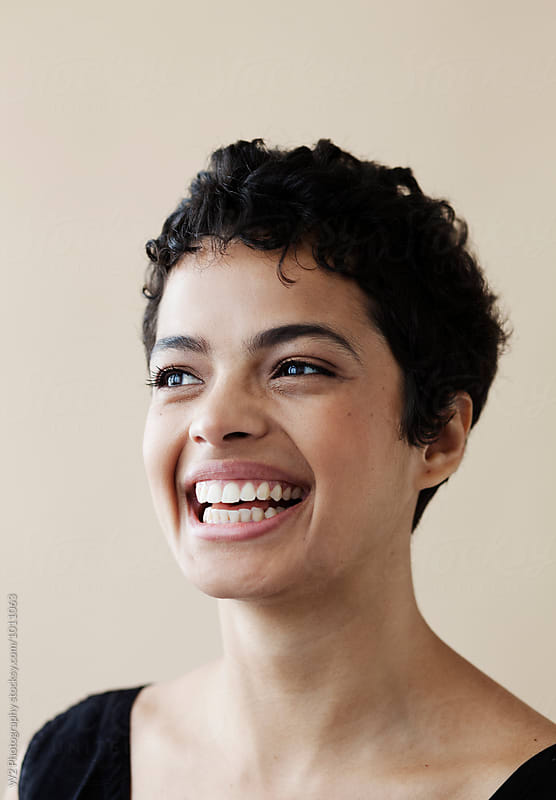 Close up portrait of woman smiling. by W2 Photography for Stocksy United