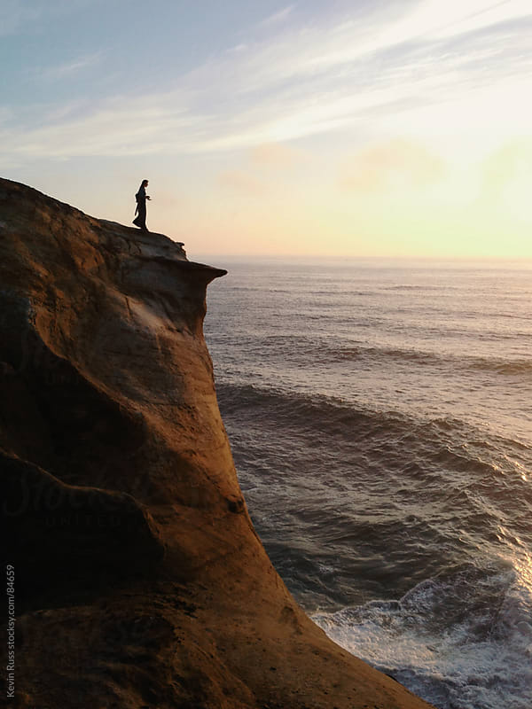 Woman on Ocean Cliff by Kevin Russ for Stocksy United