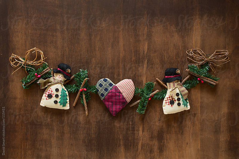 Rustic Christmas decoration on dark wood background by David Smart for Stocksy United