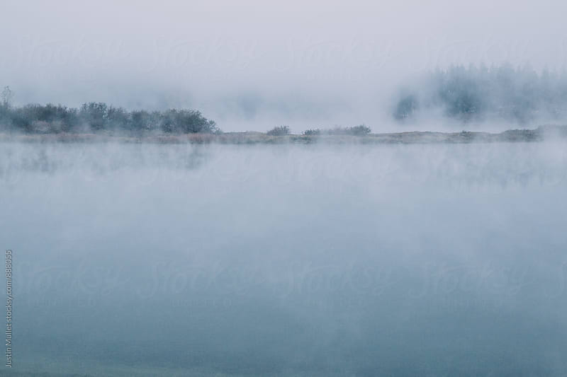 Cool, foggy morning on the river by Justin Mullet for Stocksy United