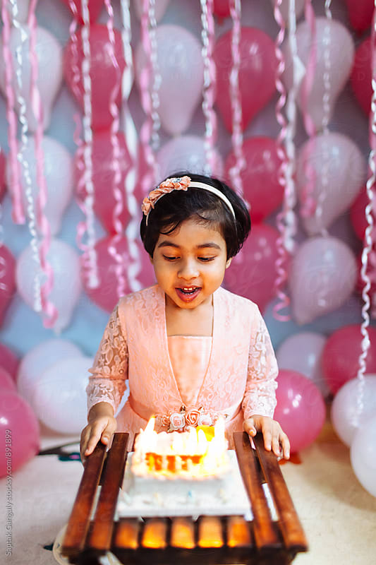 Cute little girl with her birthday cake by Saptak Ganguly for Stocksy United