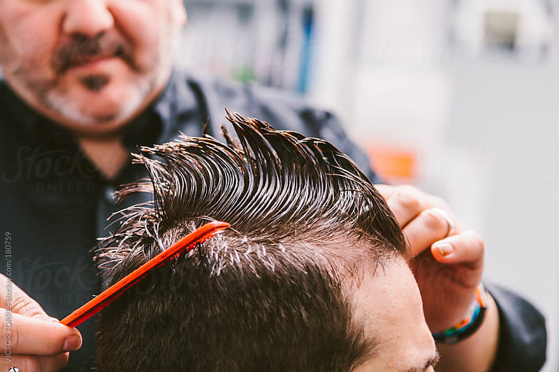 Barber Cutting Hair to a Client by VICTOR TORRES for Stocksy United