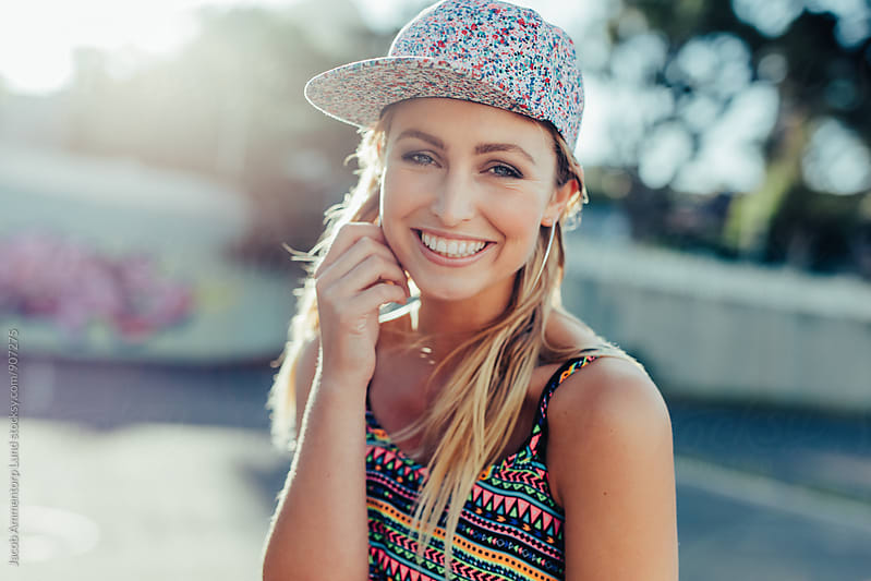 Attractive young girl smiling at camera by Jacob Lund for Stocksy United