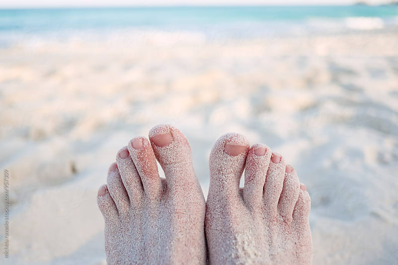 Female feet covered with fine white sand by michela ravasio for Stocksy United