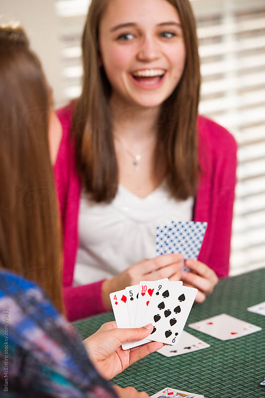Teens Playing Cards by Brian McEntire for Stocksy United
