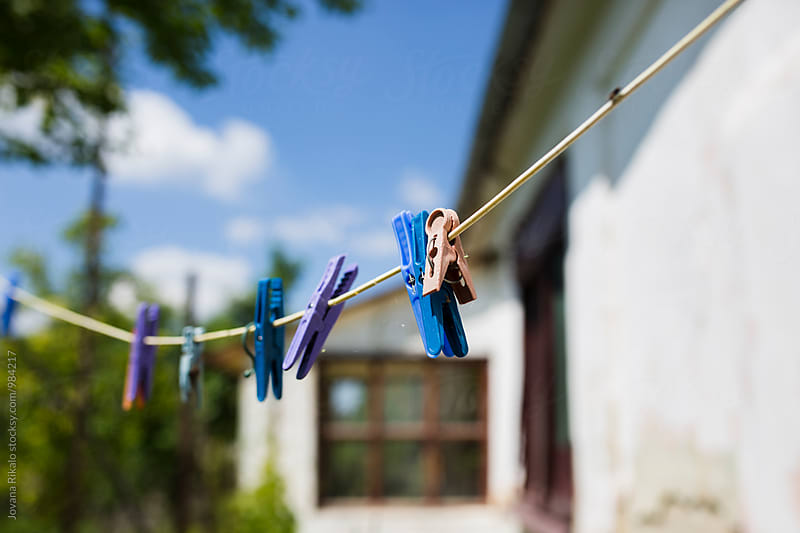 Pegs on a washing line by Jovana Rikalo for Stocksy United