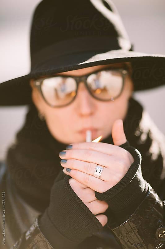 portrait of smoking androgyne by Alexey Kuzma for Stocksy United