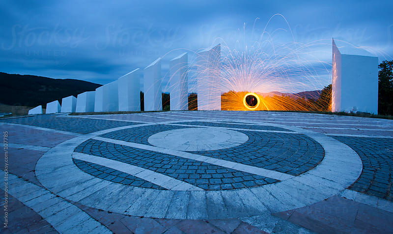 Spinning fire sparkles at communistic monument by Marko Milovanović for Stocksy United