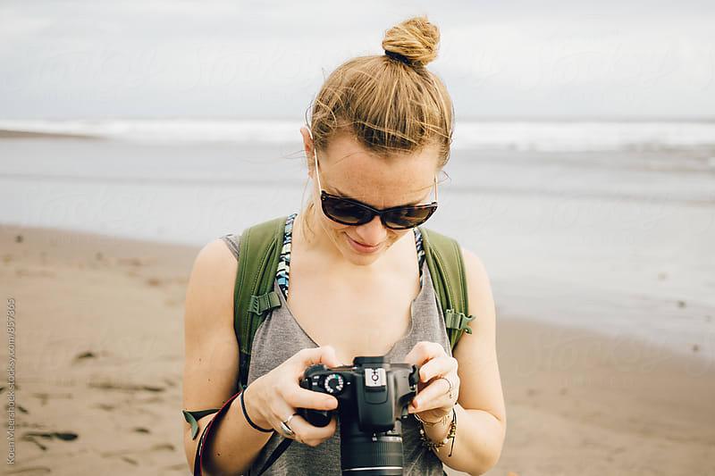Female traveller with her camera on the beach by Koen Meershoek for Stocksy United