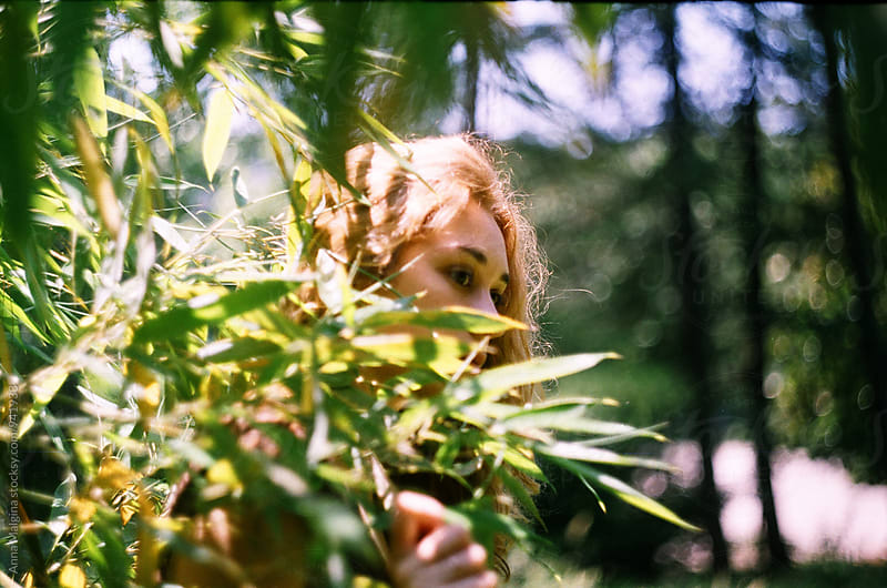 A film portrait of young beautiful woman under the tree by Anna Malgina for Stocksy United