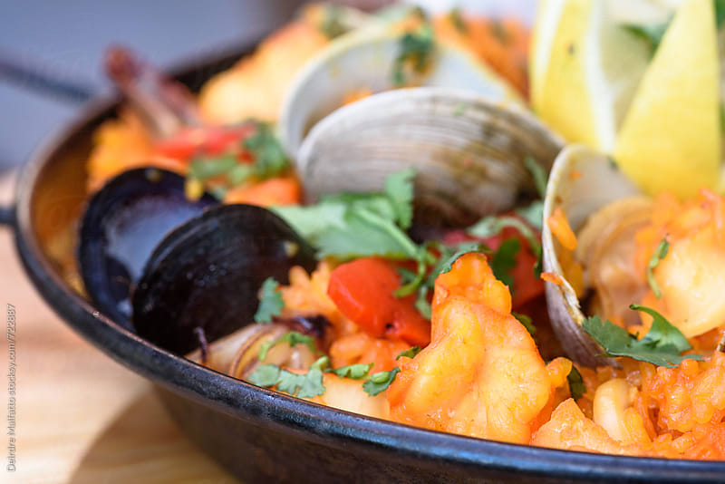 close up of a pan of paella by Deirdre Malfatto for Stocksy United