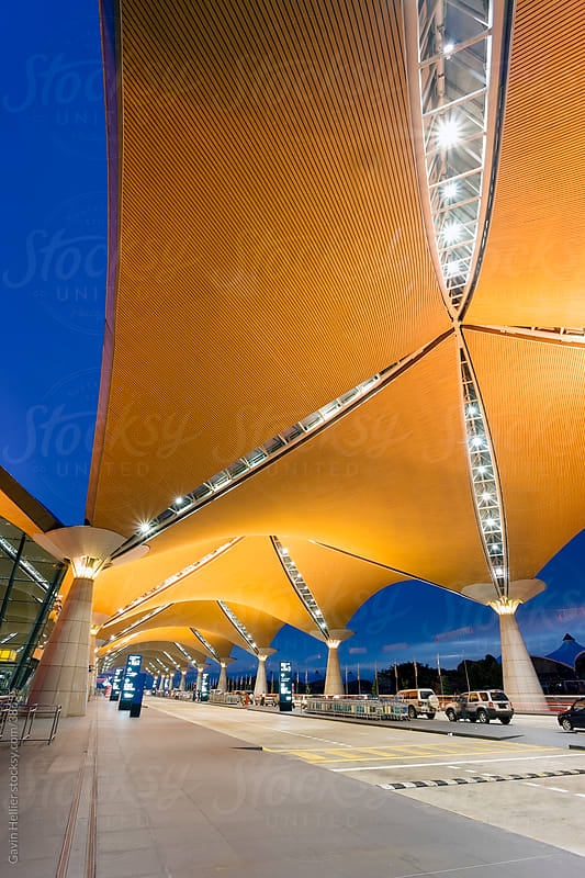Asia, Malaysia, Kuala Lumpur, Kuala Lumpur International Airport (KLIA), modern exterior architecture by Gavin Hellier for Stocksy United