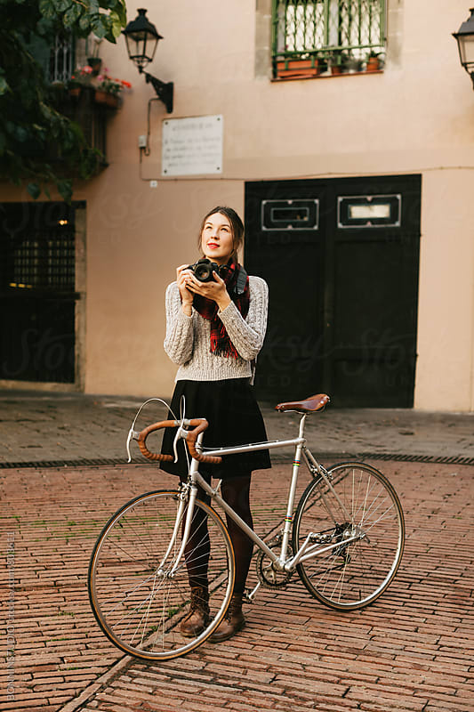 Tourist with her vintage bicycle taking photos of the city. by BONNINSTUDIO for Stocksy United