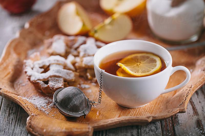 Tea with lemon and apple tart by Davide Illini for Stocksy United