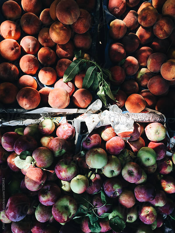 Overhead image of apples and peaches at a market in Turkey by Kirstin Mckee for Stocksy United