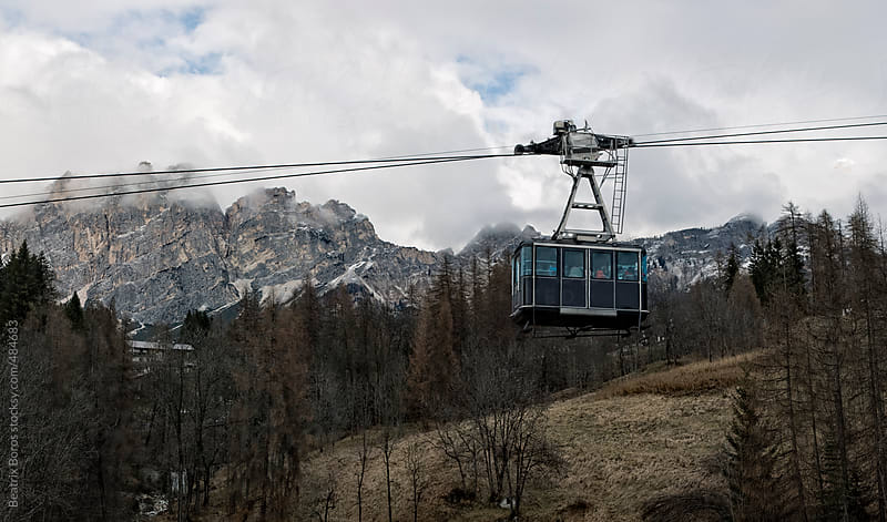 Cable car going up in the mountain with beautiful view by Beatrix Boros for Stocksy United