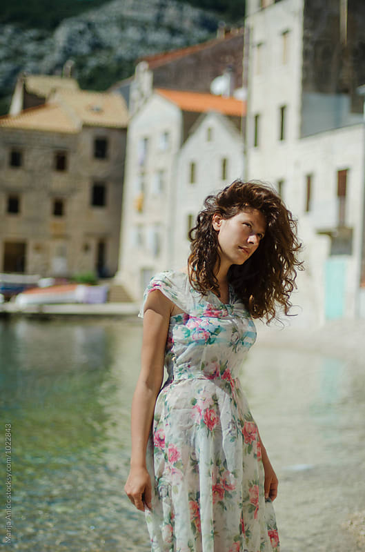 Brunette in summer floral dress  by Marija Anicic for Stocksy United