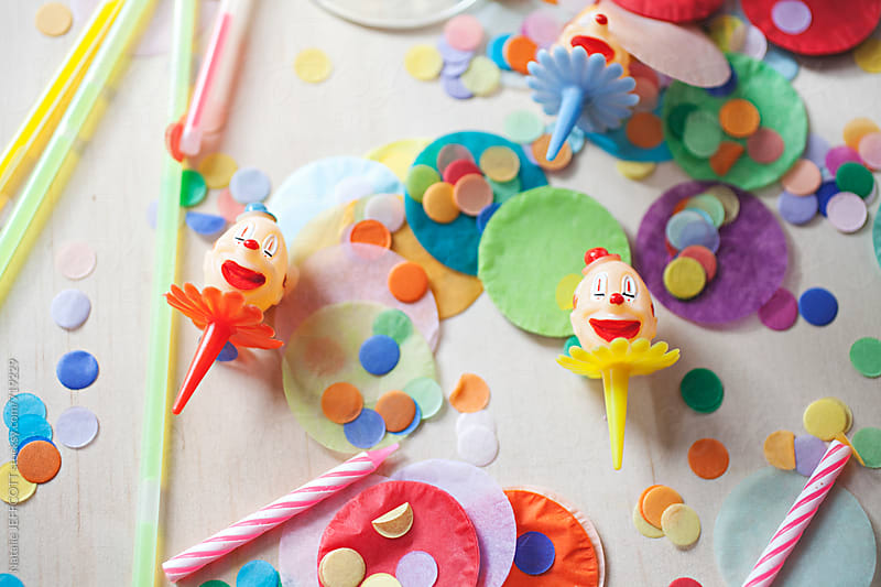 colourful confetti and party favours on tabletop by Natalie JEFFCOTT for Stocksy United