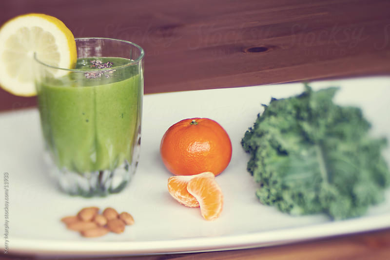 Healthy green smoothie ingredients by Kerry Murphy for Stocksy United