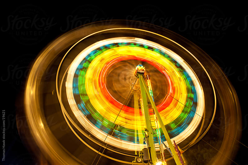 ferris wheel in motion by Thomas Hawk for Stocksy United
