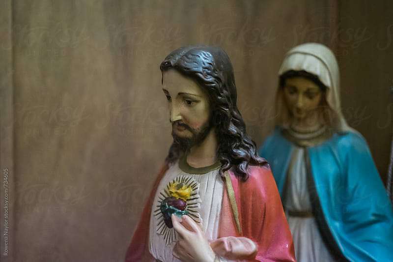 Jesus and Mary statues by Rowena Naylor for Stocksy United