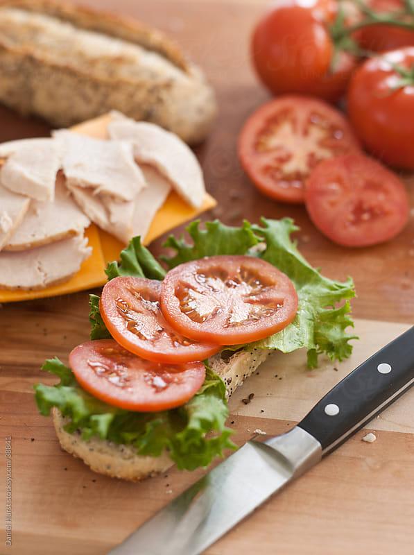 Sandwich ingredients on cutting board by Daniel Hurst for Stocksy United