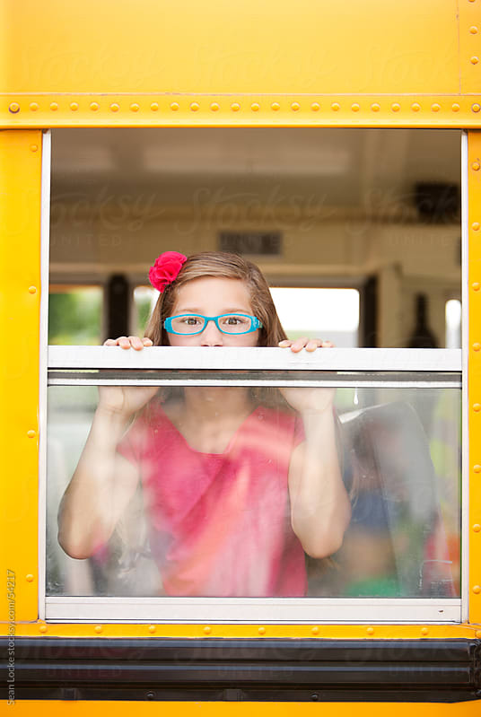 School Bus: Focus on Girl with Glasses by Sean Locke for Stocksy United