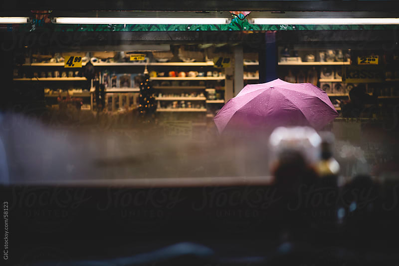 Pedestrian with umbrella during a rainy day by GIC for Stocksy United