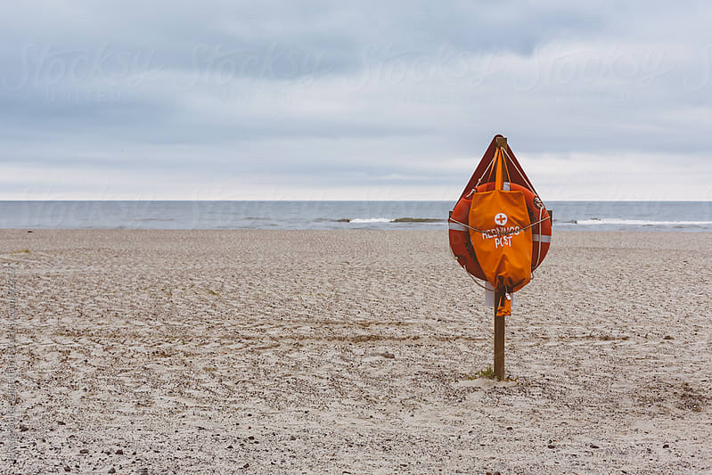 Rescue post on beach by Photographer Christian B for Stocksy United