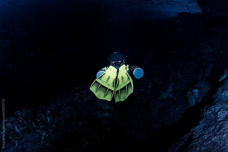 A scuba diver swimming in Mexico's  Cenote Chiken Ha by Song Heming for Stocksy United