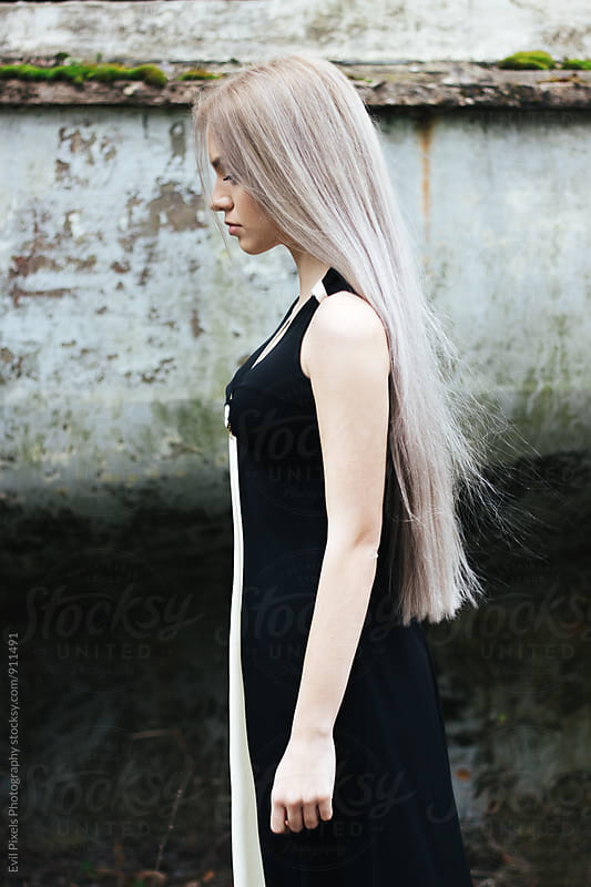 Portrait of a beautiful female model with long pastel hair by Branislava Živić for Stocksy United