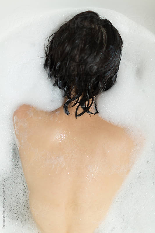 Girl in bathtub by Tommaso Tuzj for Stocksy United